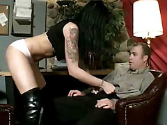 Tattooed goth beauty in boots gives oral pleasure.