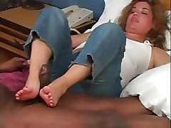 mature interracial footjob