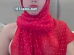 arab teen in red hijab exposes her pretty breasts on webcam fingering