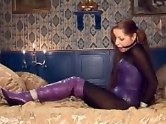 sexy model hogtied and ball gagged in purple boots