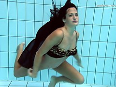 pure dark brunette beauty underwater in the pool on cam