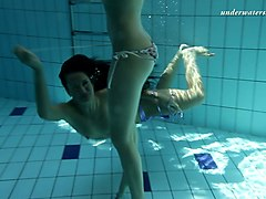 two fresh european sexy teenies underwater showing bodies