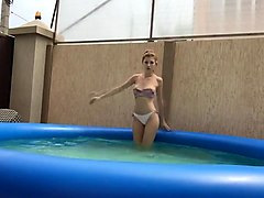 Hot college girl teases in pool
