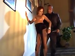 Tattooed Redhead - Black Dress Seduction On Staircase