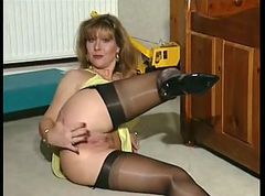 British MILF slut Anna in a solo scene on the bed