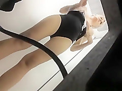 Mature woman caught trying new swimsuits