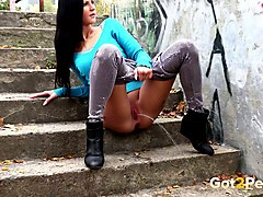 hot tall brunette babe sits on the stairs shoots a long range jet of piss