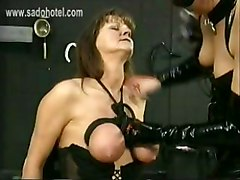 Masked Dominatrix In Latex Ties The Big Tits Of Slave With Together With A Rope And Hits Them With A Whip
